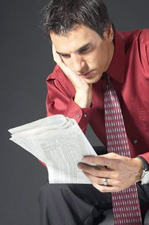 Business man reading stock quotes BE 7 - About Us